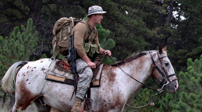Tim Kennedy on horseback