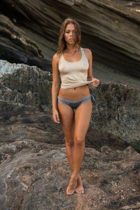 Annika Bauer in swimwear and thin top.