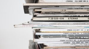 Beatles rock record in middle of stack of records