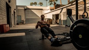 A man strength training on a rowing machine